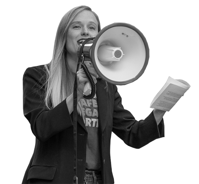 Woman with long-blonde hair smiles and talks with a megaphone.